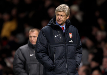 MANCHESTER, ENGLAND - DECEMBER 13:  Arsenal Manager Arsene Wenger heads for the dressing room at half time during the Barclays Premier League match between Manchester United and Arsenal at Old Trafford on December 13, 2010 in Manchester, England.  (Photo