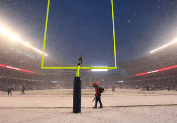 CHICAGO, IL - DECEMBER 12: Workers clear the yard markers during a time-out of a game between the Chicago Bears and the New England Patriots at Soldier Field on December 12, 2010 in Chicago, Illinois. The Patriots defeated the Bears 36-7. (Photo by Jonath