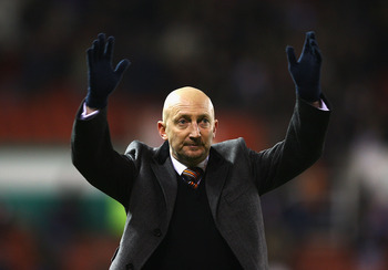 STOKE ON TRENT, ENGLAND - DECEMBER 11:  Ian Holloway, manager of Blackpool thanks the supporters during the Barclays Premier League match between Stoke City and Blackpool at Britannia Stadium on December 11, 2010 in Stoke on Trent, England.  (Photo by Mat
