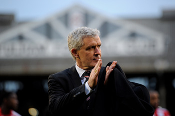 LONDON, ENGLAND - DECEMBER 11:  Mark Hughes manager of Fulham applauds the fans ahead of the Barclays Premier League match between Fulham and Sunderland at Craven Cottage on December 11, 2010 in London, England.  (Photo by Clive Mason/Getty Images)