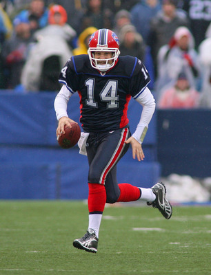 ORCHARD PARK, NY - DECEMBER 12: Ryan Fitzpatrick #14 of the Buffalo Bills runs against the Cleveland Browns at Ralph Wilson Stadium on December 12, 2010 in Orchard Park, New York.  (Photo by Rick Stewart/Getty Images)