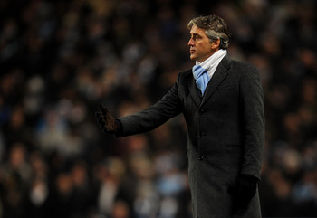 MANCHESTER, ENGLAND - DECEMBER 04:  Manchester City Manager Roberto Mancini gestures during the Barclays Premier League match between Manchester City and Bolton Wanderers at the City of Manchester Stadium on December 4, 2010 in Manchester, England.  (Phot