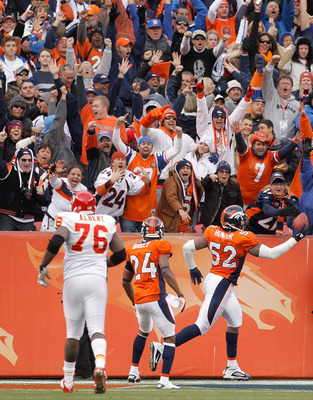 DENVER - NOVEMBER 14:  Linebacker Jason Hunter #52 of the Denver Broncos celebrates a fumble recovery and 75-yard run for a touchdown with teammate Champ Bailey #24 as offensive tackle Branden Albert #76 of the Kansas City Chiefs unsuccessfully gives chas