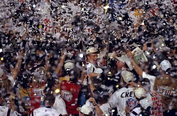 31 Jan 1999: Confetti rains down as quarterback John Elway #7 of the Denver Broncos is mobbed by teammates and fans after defeating the Atlanta Falcons to win Super Bowl XXXIII at Pro Player Stadium in Miami, Florida. The Broncos defeated the Falcons 34-1