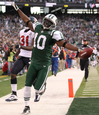 EAST RUTHERFORD, NJ - NOVEMBER 21:  Santonio Holmes #10 of the New York Jets scores a touchdown against the Houston Texans during the third quarter of their  game on November 21, 2010 at the New Meadowlands Stadium in East Rutherford, New Jersey.  (Photo