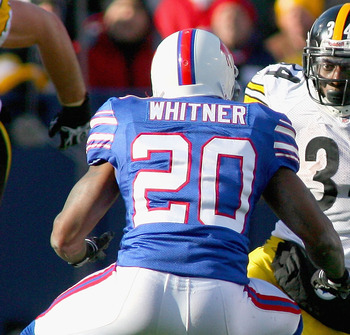 ORCHARD PARK, NY - NOVEMBER 28: Rashard Mendenhall #34  of the Pittsburgh Steelers runs against Donte Whitner #20 of the Buffalo Bills  at Ralph Wilson Stadium at Ralph Wilson Stadium on November 28, 2010 in Orchard Park, New York.  (Photo by Rick Stewart