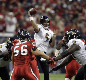 HOUSTON, TX - DECEMBER 13:  Quarterback Joe Flacco #5 of the Baltimore Ravens throws over the Houston Texans defense at Reliant Stadium on December 13, 2010 in Houston, Texas.  (Photo by Bob Levey/Getty Images)