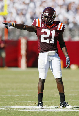 BLACKSBURG, VA - SEPTEMBER 18: Cornerback Rashad Carmichael #21 of the Virginia Tech Hokies signals on field against the East Carolina Pirates at Lane Stadium on September 18, 2010 in Blacksburg, Virginia. Virginia Tech won 49-27.  (Photo by Geoff Burke/G