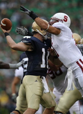 SOUTH BEND, IN - SEPTEMBER 25: Shayne Skov #11 of the Stanford Cardinal hits Dayne Crist #10 of the Notre Dame Fighting Irish forcing Crist to fumble at Notre Dame Stadium on September 25, 2010 in South Bend, Indiana.  (Photo by Jonathan Daniel/Getty Imag