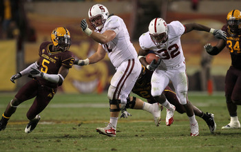 TEMPE, AZ - NOVEMBER 13:  Running back Anthony Wilkerson #32 of the Stanford Cardinal carries the ball as center Chase Beeler #71 blocks cornerback LeQuan Lewis #5 of the Arizona State Sun Devils  at Sun Devil Stadium on November 13, 2010 in Tempe, Arizon