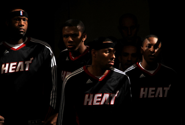 SACRAMENTO, CA - DECEMBER 11:  The Miami Heat walk on to the court for their game against the Sacramento Kings at ARCO Arena on December 11, 2010 in Sacramento, California.  NOTE TO USER: User expressly acknowledges and agrees that, by downloading and or