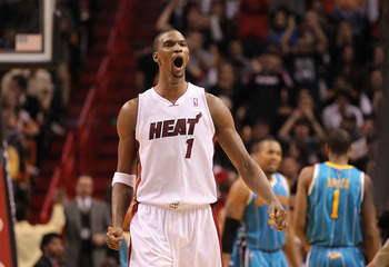 MIAMI, FL - DECEMBER 13:  Chris Bosh #1 of the Miami Heat reacts after making a 3 pointer during a game against the New Orleans Hornets at American Airlines Arena on December 13, 2010 in Miami, Florida. NOTE TO USER: User expressly acknowledges and agrees