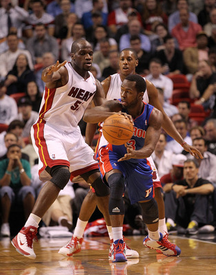 MIAMI, FL - DECEMBER 01:  Will Bynum #12 of the Detroit Pistons passes away from Joel Anthony #50 of the Miami Heat during a game at American Airlines Arena on December 1, 2010 in Miami, Florida. NOTE TO USER: User expressly acknowledges and agrees that,
