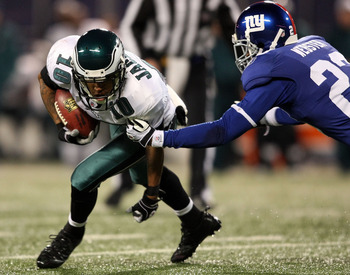 EAST RUTHERFORD, NJ - DECEMBER 13:  DeSean Jackson #10 of the Philadelphia Eagles runs with the ball against Corey Webster #23 of the New York Giants at Giants Stadium on December 13, 2009 in East Rutherford, New Jersey.  (Photo by Nick Laham/Getty Images