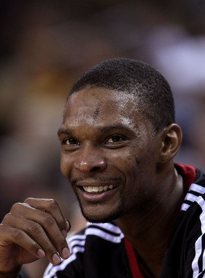 OAKLAND, CA - DECEMBER 10:  Chris Bosh #1 of the Miami Heat sits on the bench during their game against the Golden State Warriors at Oracle Arena on December 10, 2010 in Oakland, California. NOTE TO USER: User expressly acknowledges and agrees that, by do