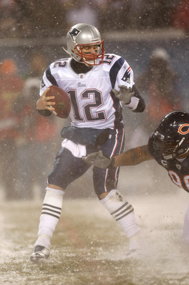 CHICAGO, IL - DECEMBER 12: Tom Brady #12 of the New England Patriots runs against the Chicago Bears at Soldier Field on December 12, 2010 in Chicago, Illinois. The Patriots defeated the Bears 36-7. (Photo by Scott Boehm/Getty Images)