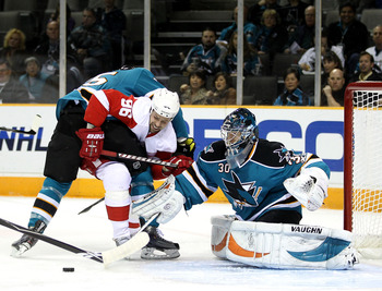 SAN JOSE, CA - NOVEMBER 30:  Tomas Holmstrom #96 of the Detroit Red Wings tries to score on Derek Joslin #65 of the San Jose Sharks and Antero Niittymaki #30 of the San Jose Sharks at HP Pavilion on November 30, 2010 in San Jose, California.  (Photo by Ez