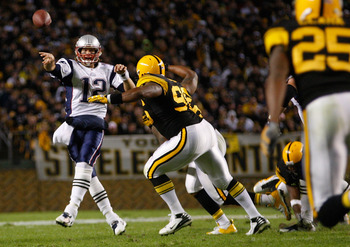 PITTSBURGH, PA - NOVEMBER 14:  Tom Brady #12 of the New England Patriots throws a pass around the Pittsburgh Steelers defense during the game on November 14, 2010 at Heinz Field in Pittsburgh, Pennsylvania.  (Photo by Jared Wickerham/Getty Images)