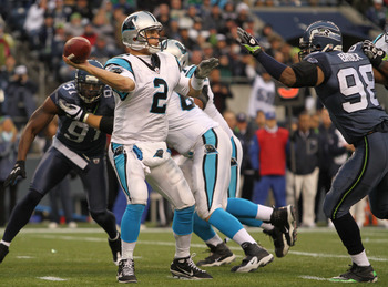 SEATTLE - DECEMBER 05:  Quarterback Jimmy Clausen #2 of the Carolina Panthers passes against Raheem Brock #98 of the Seattle Seahawks at Qwest Field on December 5, 2010 in Seattle, Washington. The Seahawks won, 31-14. (Photo by Otto Greule Jr/Getty Images