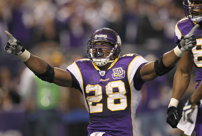 MINNEAPOLIS - NOVEMBER 7: Running back Adrian Peterson #28 of the Minnesota Vikings celebrates after his four yard touchdown run brought the Vikings within a touchdown of the Arizona Cardinals in the fourth quarter at Hubert H. Humphrey Metrodome on Novem