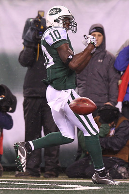 EAST RUTHERFORD, NJ - DECEMBER 12: Santonio Holmes #10 of the New York Jets drops a pass in the endzone against the Miami Dolphins at New Meadowlands Stadium on December 12, 2010 in East Rutherford, New Jersey.  (Photo by Nick Laham/Getty Images)