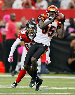 ATLANTA - OCTOBER 24:  Chad Ochocinco #85 of the Cincinnati Bengals pulls in this reception against Brent Grimes #20 of the Atlanta Falcons at Georgia Dome on October 24, 2010 in Atlanta, Georgia.  (Photo by Kevin C. Cox/Getty Images)