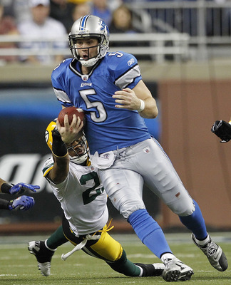 DETROIT - DECEMBER 12: Drew Stanton #5 of the Detroit Lions runs for a first down as Charles Woodson #21 of the Green Bay Packers attempts to make the stop during the game at Ford Field on December 12, 2010 in Detroit, Michigan. The Lions defeated the Pac