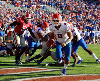 JACKSONVILLE, FL - OCTOBER 30:  Quarterback Trey Burton #8 of the Florida Gators runs for a touchdown during the game against the Georgia Bulldogs at EverBank Field on October 30, 2010 in Jacksonville, Florida.  (Photo by Sam Greenwood/Getty Images)