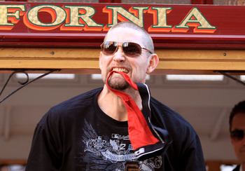 SAN FRANCISCO - NOVEMBER 03:  Aubrey Huff of the San Francisco Giants bites his red rally thong during the San Francisco Giants victory parade on November 3, 2010 in San Francisco, California.  (Photo by Ezra Shaw/Getty Images)