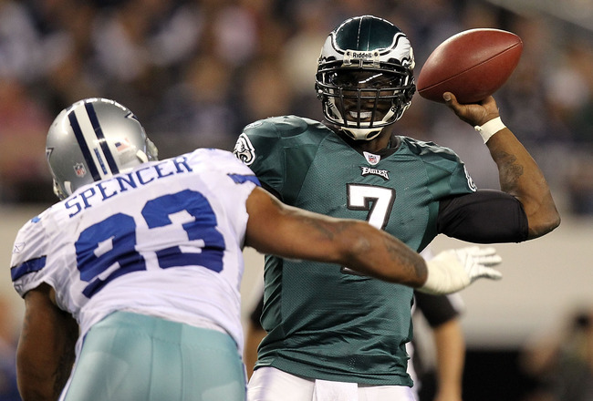 ARLINGTON, TX - DECEMBER 12:  Quarterback Michael Vick #7 of the Philadelphia Eagles drops back to pass against Anthony Spencer #93 of the Dallas Cowboys at Cowboys Stadium on December 12, 2010 in Arlington, Texas.  (Photo by Ronald Martinez/Getty Images)