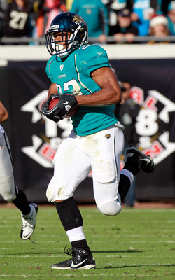 JACKSONVILLE, FL - DECEMBER 12:  Rashad Jennings #23 of the Jacksonville Jaguars runs during the game against the Oakland Raiders at EverBank Field on December 12, 2010 in Jacksonville, Florida.  (Photo by Sam Greenwood/Getty Images)