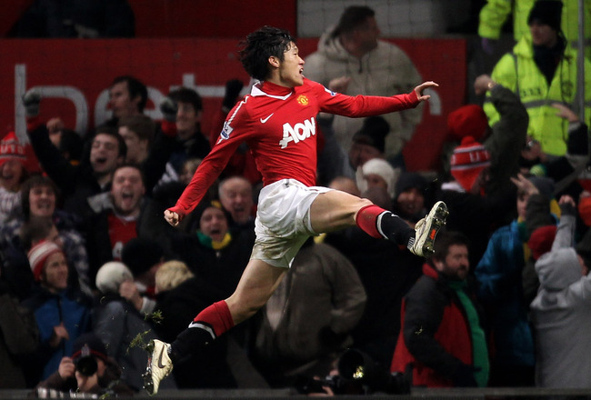 MANCHESTER, UNITED KINGDOM - DECEMBER 13:   Ji-Sung Park of Manchester United celebrates scoring the opening goal during the Barclays Premier League match between Manchester United and Arsenal at Old Trafford on December 13, 2010 in Manchester, England. (