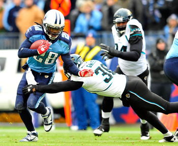 NASHVILLE, TN - DECEMBER 05:  Chris Johnson #28 of the Tennessee Titans runs against Courtney Greene #36 of the Jacksonville Jaguars during the first half at LP Field on December 5, 2010 in Nashville, Tennessee.  (Photo by Grant Halverson/Getty Images)