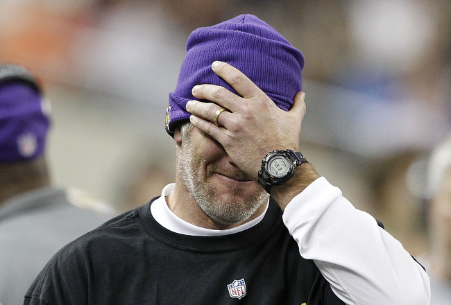 DETROIT - DECEMBER 13:  Quarterback Brett Favre #4 of the Minnesota Vikings covers his face with his hand during the game against the New York Giants at Ford Field on December 13, 2010 in Detroit, Michigan. The Giants defeated the Vikings 21-3.  (Photo by
