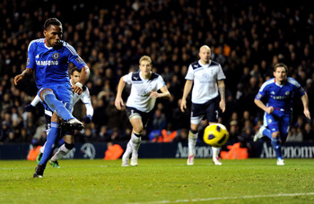 LONDON, ENGLAND - DECEMBER 12: Didier Drogba of Chelsea takes a penalty kick, which is saved by Spurs Goalkeeper Heurelho Gomes during the Barclays Premier League match between Tottenham Hotspur and Chelsea at White Hart Lane on December 12, 2010 in Londo