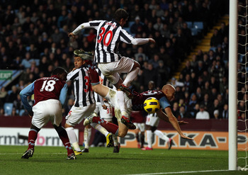 BIRMINGHAM, ENGLAND - DECEMBER 11:  Emile Heskey of Villa scores the second goal during the Barclays Premier League match between Aston Villa and West Bromwich Albion at Villa Park on December 11, 2010 in Birmingham, England.  (Photo by Richard Heathcote/