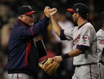CHICAGO - SEPTEMBER 14: Manager Ron Gardenhire #35 of the Minnesota Twins congratulates J.J. Hardy #27 after a win over the Chicago White Sox at U.S. Cellular Field on September 14, 2010 in Chicago, Illinois. The Twins defeated the White Sox 9-3.  (Photo