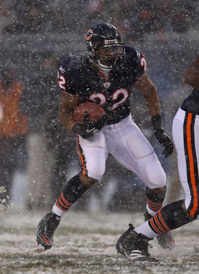 CHICAGO, IL - DECEMBER 12: Matt Forte #22 of the Chicago Bears looks for running room against the New England Patriots at Soldier Field on December 12, 2010 in Chicago, Illinois. The Patriots defeated the Bears 36-7. (Photo by Jonathan Daniel/Getty Images