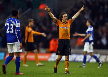 WOLVERHAMPTON, ENGLAND - DECEMBER 12:  Wolves goal scorer Stephen Hunt celebrates victory at the final whistle during the Barclays Premier League match between Wolverhampton Wanderers and Birmingham City at Molineux on December 12, 2010 in Wolverhampton,