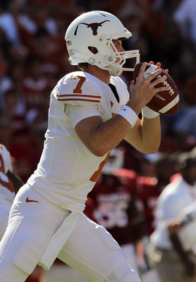 DALLAS - OCTOBER 02:  Quarterback Garrett Gilbert #7 of the Texas Longhorns drops back to pass against the Oklahoma Sooners in the second quarter at the Cotton Bowl on October 2, 2010 in Dallas, Texas.  (Photo by Ronald Martinez/Getty Images)