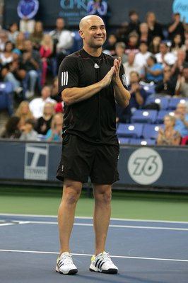 LOS ANGELES, CA - JULY 24:  Andre Agassi stands during a check presentation before playing against John McEnroe in the Stars Under the Stars gala on July 24, 2010 at the Los Angeles Tennis Center in Los Angeles, California.  (Photo by Jeff Golden/Getty Im