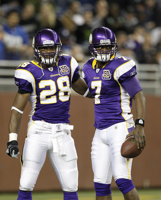DETROIT, MI - DECEMBER 13: Adrian Peterson #28 and Tavaris Jackson #7 of the Minnesota Vikings prior to the start of the game against the New York Giants on December 13, 2010 in Detroit, Michigan.  (Photo by Leon Halip/Getty Images)