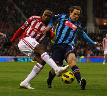 STOKE ON TRENT, ENGLAND - DECEMBER 11:  Ricardo Fuller of Stoke and David Vaughan of Blackpool challenge for the ball during the Barclays Premier League match between Stoke City and Blackpool at Britannia Stadium on December 11, 2010 in Stoke on Trent, En