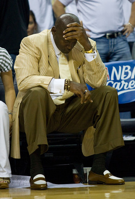 CHARLOTTE, NC - APRIL 26:  Charlotte Bobcats principal owner Michael Jordan reacts as time winds down against the Orlando Magic in Game Four of the Eastern Conference Quarterfinals during the 2010 NBA Playoffs at Time Warner Cable Arena on April 26, 2010