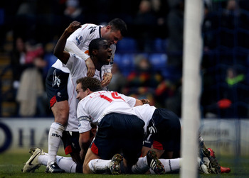 BOLTON, ENGLAND - DECEMBER 12:  Stuart Holden (obscured) of Bolton Wanderers is mobbed by his team mates after scoring the winning goal during the Barclays Premier League match between Bolton Wanderers and Blackburn Rovers at the Reebok Stadium on Decembe