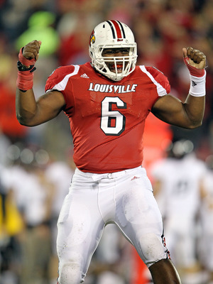 LOUISVILLE, KY - OCTOBER 15:  Greg Scruggs #6 of  the Louisville Cardinals  celebrates after intercepting a pass during the Big East Conference game against the Cincinnati Bearcats at Papa John's Cardinal Stadium on October 15, 2010 in Louisville, Kentuck