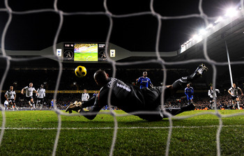LONDON, ENGLAND - DECEMBER 12: Goalkeeper Heurelho Gomes of Spurs saves the penalty from Didier Drogba of Chelsea to keep the score at 1-1 during the Barclays Premier League match between Tottenham Hotspur and Chelsea at White Hart Lane on December 12, 20