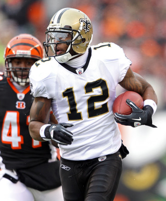 CINCINNATI, OH - DECEMBER 05:  Marques Colston #12 of the New Orleans Saints runs with the ball during the NFL game against the Cincinnati Bengals at Paul Brown Stadium on December 5, 2010 in Cincinnati, Ohio.  The Saints won 34-30.  (Photo by Andy Lyons/