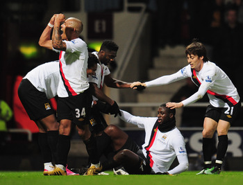 LONDON, UNITED KINGDOM - DECEMBER 11:  Yaya Toure (2nd right) of Manchester City is congratulated by team mates during the Barclays Premier League match between West Ham United and Manchester City at Upton Park on December 11, 2010 in London, England.  (P