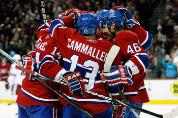 MONTREAL, QC - OCTOBER 25:  Tomas Plekanec #14 of the Montreal Canadiens celebrates his second period goal with team mates during the NHL game against the Phoenix Coyotes at the Bell Centre on October 25, 2010 in Montreal, Quebec, Canada.  The Canadiens d